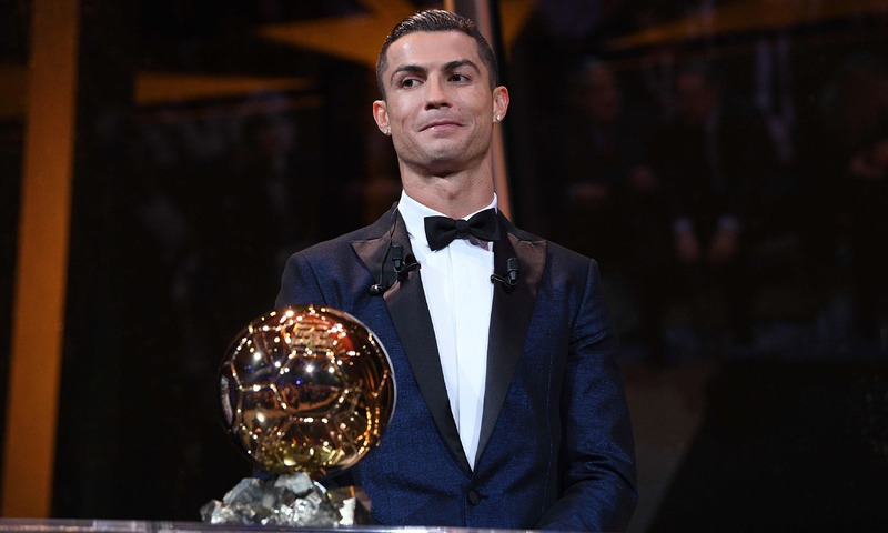 Cristiano Ronaldo posing with the Ballon d'Or France Football trophy in Paris. —AFP