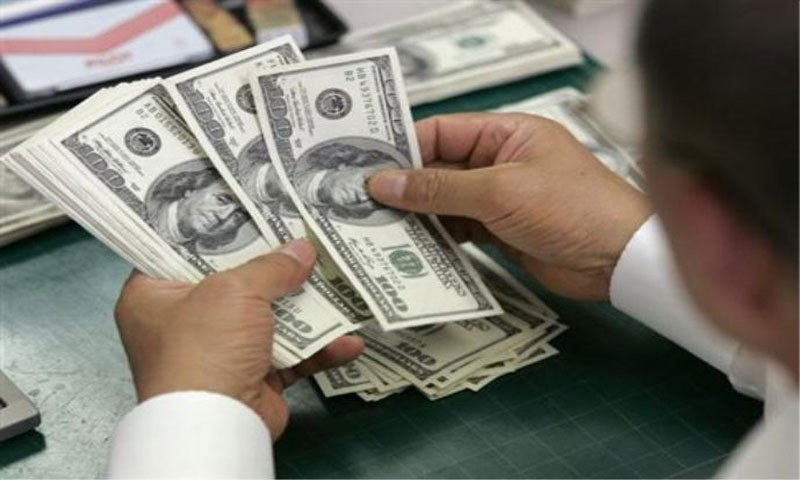A Money Dealer Counts Us Dollar Notes At Currency Exchange In The File Photo