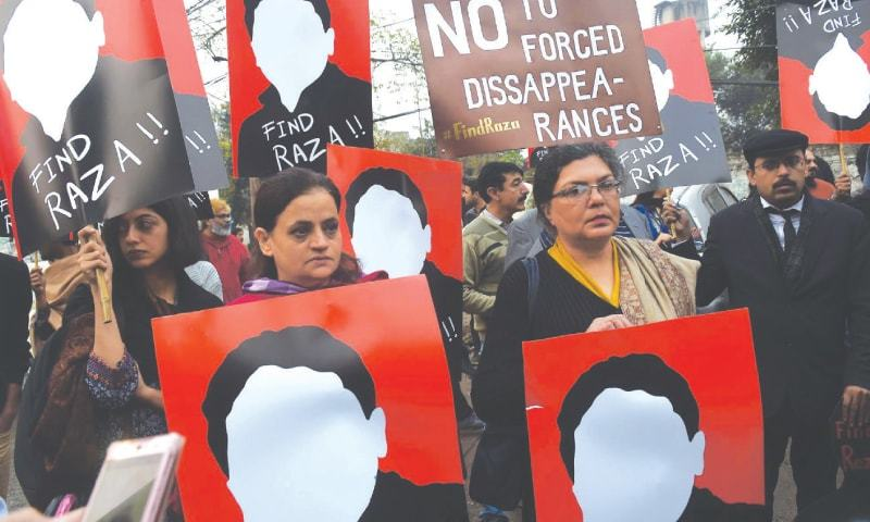 FAMILY and members of civil society protest against the enforced disappearance of human rights activist Raza Khan at the Lahore Press Club.—Arif Ali / White Star