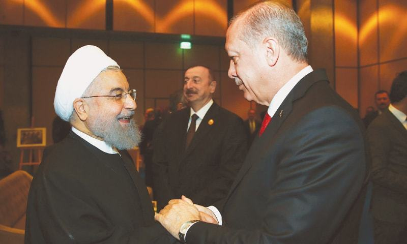 TURKISH President Recep Tayyip Erdogan welcomes his Iranian counterpart Hassan Rouhani at an extraordinary summit of the Organisation of Islamic Cooperation on Wednesday.—AFP