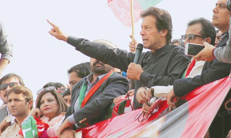 KARACHI: PTI chairman Imran Khan addressing party workers at the Quaidabad Chowk on Wednesday.—INP