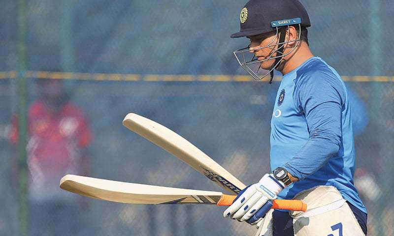 MAHENDRA Singh Dhoni checks his bats during a practice session ahead of India's third ODI against Sri Lanka.—AP