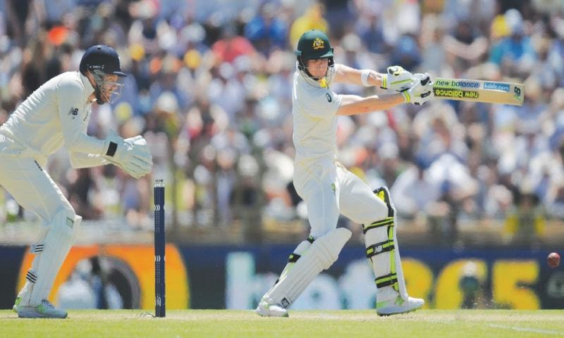 PERTH: Australian captain Steve Smith drives during his unbeaten double century as England wicket-keeper Jonny Bairstow looks on during the third Ashes Test at the WACA Ground on Saturday.—AFP