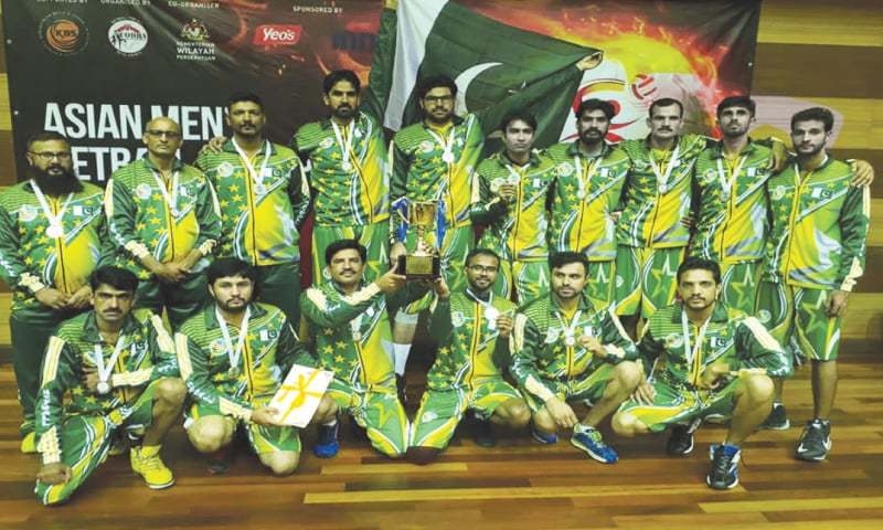 KUALA LUMPUR: Pakistan netball team players and officials pose after the final of the Asian Netball Championship on Sunday.