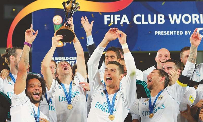 ABU DHABI: Real Madrid's (front L-R) Marcelo, Luka Modric, Cristiano Ronaldo and Sergio Ramos celebrate with the FIFA Club World Cup trophy following their victory in the final against Gremio at the Zayed Sports City Stadium.—AFP