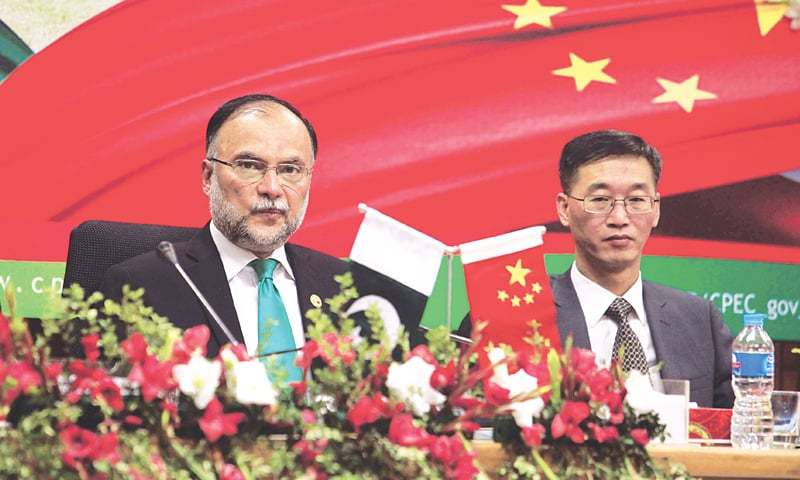 PLANNING and Development Minister Ahsan Iqbal and Chinese Ambassador Yao Jing attend launching ceremony of CPEC Long Term Plan on Monday.—Reuters