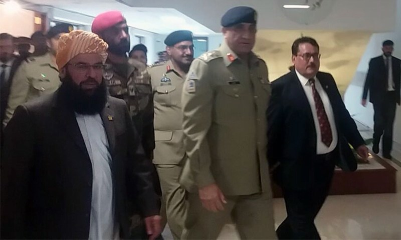 COAS Qamar Jawed Bajwa arrives at Parliament House ahead of briefing. ─ DawnNews