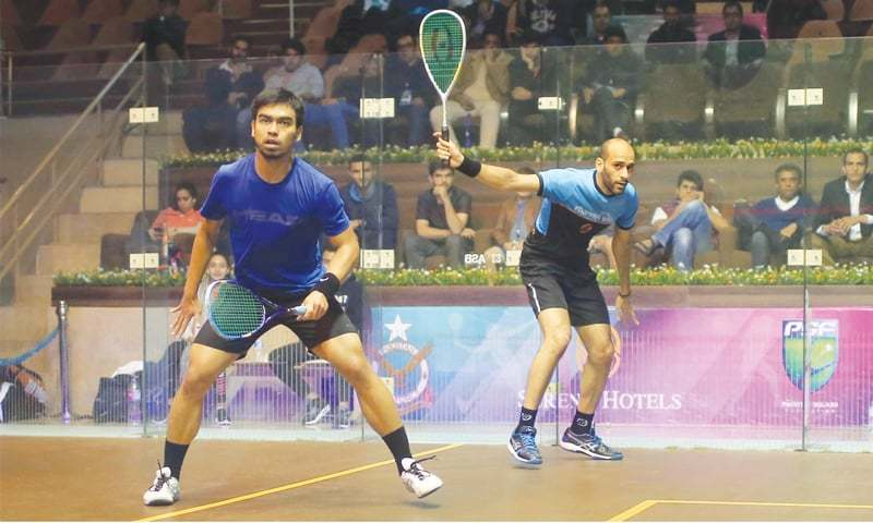 ISLAMABAD: Marwan El Shorbagy of Egypt (R) and Malaysia's Mohammad Syafiq in action during their match at the Pakistan Open on Wednesday.—courtesy PSF