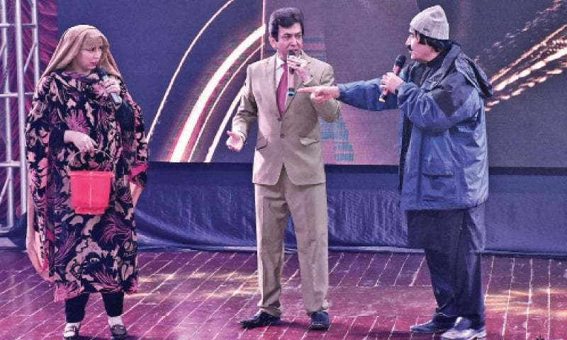 Artists stage a short play during the 'Pride of Peshawar' award ceremony at Nishtar Hall on Wednesday. — White Star