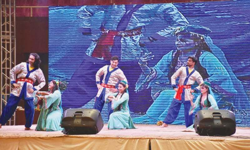 ISLAMABAD: Artists perform the traditional dances of Gilgit-Baltistan during the opening ceremony of the Quaid-i-Azam Inter-provincial Games at the Pakistan Sports Complex on Monday.—APP