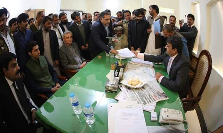 Ali Tareen was accompanied by his father while submitting nomination papers for NA-154 by-election. —Photo courtesy PTI
