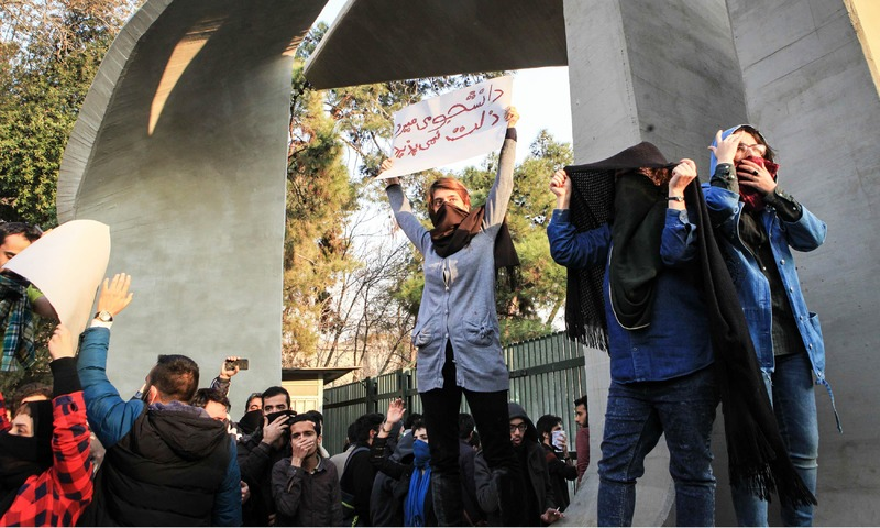 Students protest at the University of Tehran during a demonstration driven by anger over economic problems. —AFP