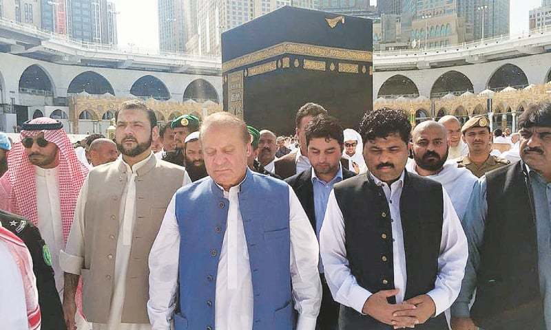 MAKKAH: Former prime minister Nawaz Sharif along with his son Hussain after offering prayers in Masjid al-Haram on Tuesday.—INP