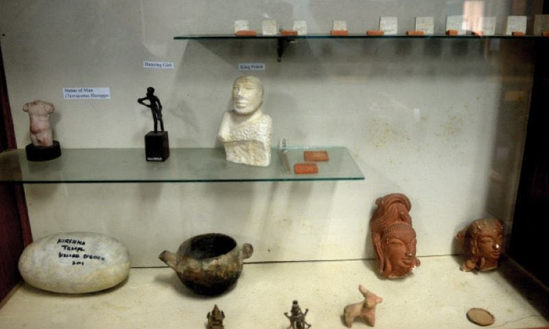 Symbolic artefacts from the Indus Valley Civilisation, including a model of the King Priest. — Photos by Mohammad Asim