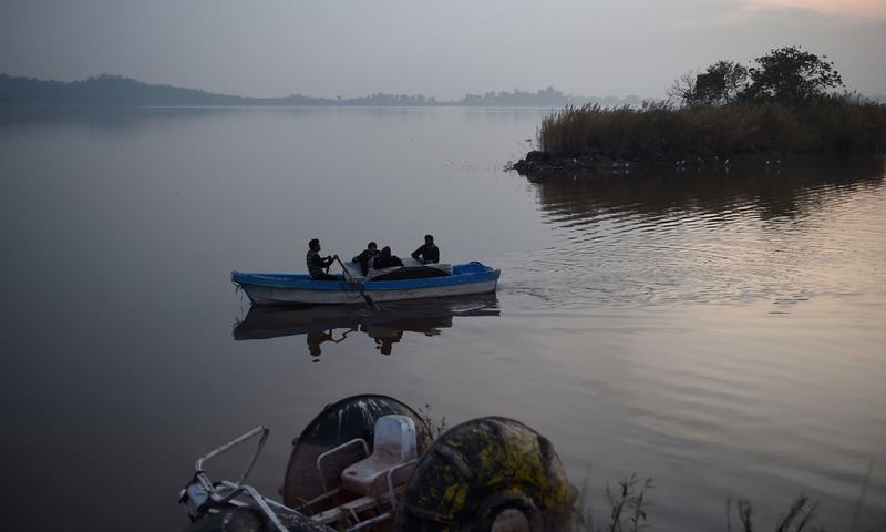 People boating in the Rawal Lake, a water storage basin, in Islamabad.— AFP