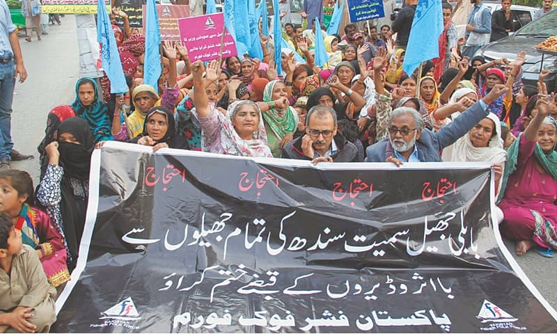 SUPPORTERS of the Pakistan Fisherfolk Forum stage a protest demonstration in front of the Karachi Press Club on Monday.—PPI