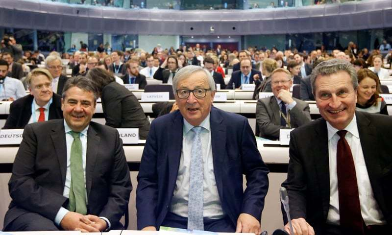 BRUSSELS: European Commission President Jean-Claude Juncker, German Foreign Minister Sigmar Gabriel and EU Budget and Human Resources Commissioner Gunther Oettinger attend a conference on the EU's next long-term budget after Brexit on Monday.—Reuters