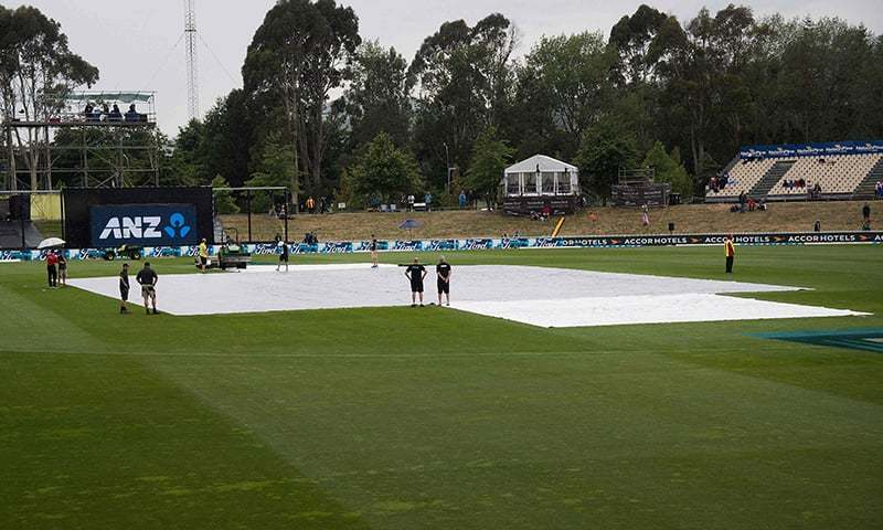 The covers lay on the field as the rain falls during the second ODI match between New Zealand and Pakistan at Saxton Oval in Nelson. — AFP