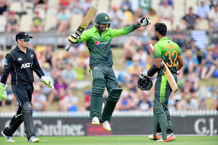 Hasan Ali (R) celebrates his 50 runs with exuberant team mate Shadab Khan (C) during the second ODI between New Zealand and Pakistan. — AFP