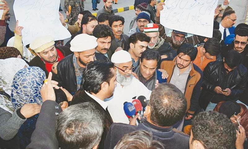 RAWALPINDI: The father of the eight-year-old girl who was raped and then murdered in Kasur talks to the media on arrival from Saudi Arabia on Wednesday.—PPI