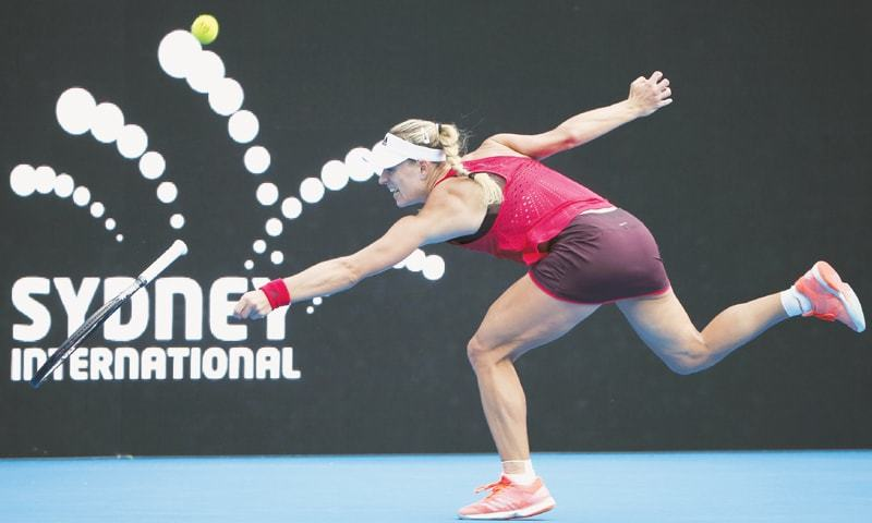 SYDNEY: Angelique Kerber of Germany loses her racket while playing a backhand to Dominika Cibulkova of Slovakia during their women's quarter-final at the Sydney International on Thursday.—AP