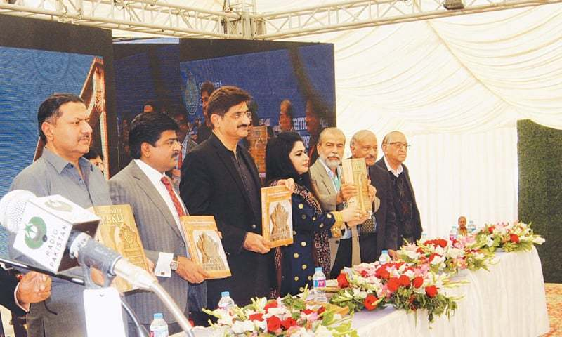 CM Syed Murad Ali Shah and other guests display the book Epigraphy of Makli launched on the first day of the conference on Saturday.—Dawn