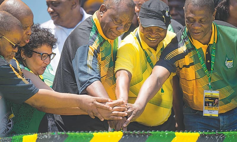 EAST LONDON: African National Congress President Cyril Ramaphosa (third from right) and other leaders cut the cake during the party's 106th anniversary celebrations on Saturday.—AFP