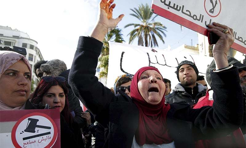 Family members of Tunisian who died in the revolution seven years ago stage a protest in Tunis Tunisia on Saturday