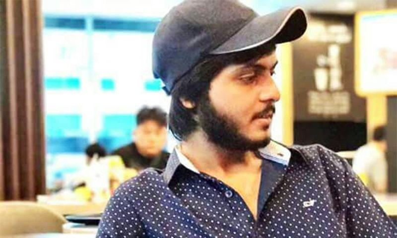 Two policemen accused of killing youth in Karachi surrender to authorities