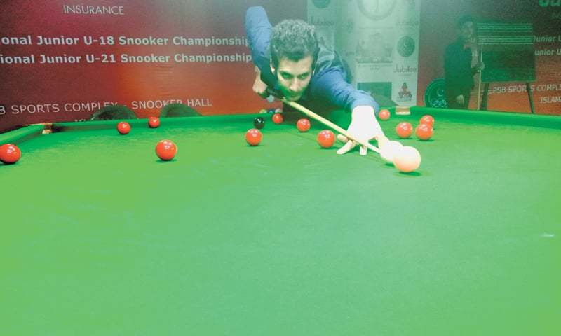 ISLAMABAD: Hamza Aftab of Khyber Pakhtunkhwa in action against Sindh's Sheheryar Khan during their match at the National Junior U-21 Snooker Championship on Monday.