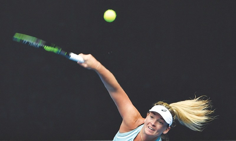 MELBOURNE: Coco Vandeweghe of the US serves to Hungary's Timea Babos during their first-round match at the Australian Open on Monday.—AFP