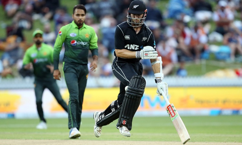 New Zealand's Kane Williamson is hit by the ball as he makes a run during the fourth one-day international. — AFP