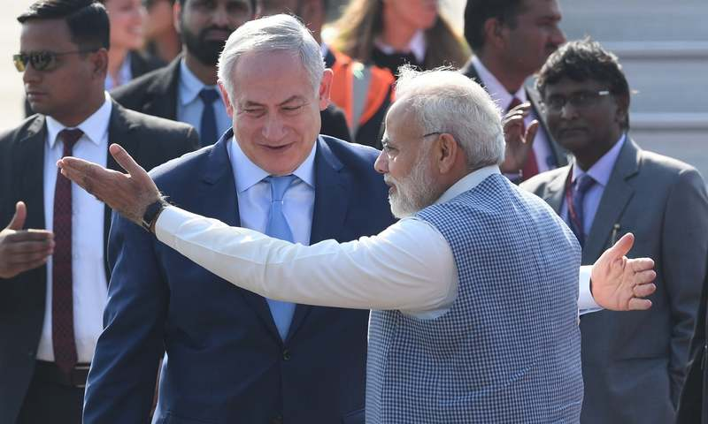 Indian PM Narendra Modi welcomes Israeli PM Netanyahu on his arrival at the Air Force Station in New Delhi — AFP