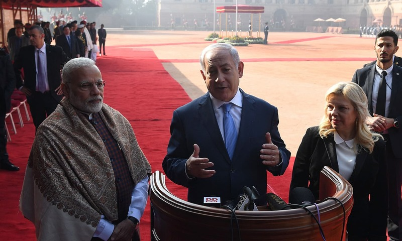 Israeli PM Netanyahu speaks to media as Indian PM Modi look on during a ceremonial reception at the Presidential Palace in New Delhi — AFP