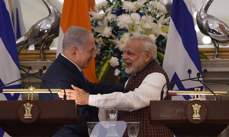 Indian PM Modi hugs Israeli PM Netanyahu during a press conference at Hyderabad House in New Delhi — AFP
