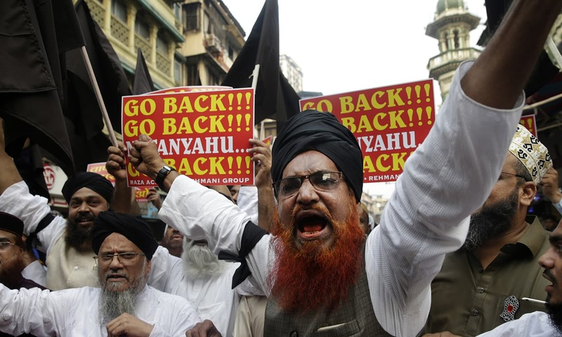 Protesters hold placards and shout slogans during a protest against the visit of Israeli PM Netanyahu in Mumbai. — AP