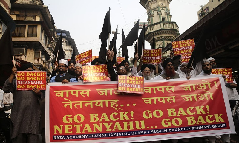 Protesters hold black flags and shout slogans during a protest against the visit of Israeli PM Netanyahu in Mumbai — AP