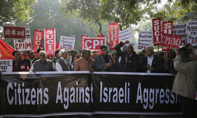 People hold placards during a protest by members of India's various left parties and civilians against the visit of Israeli PM Netanyahu — AP