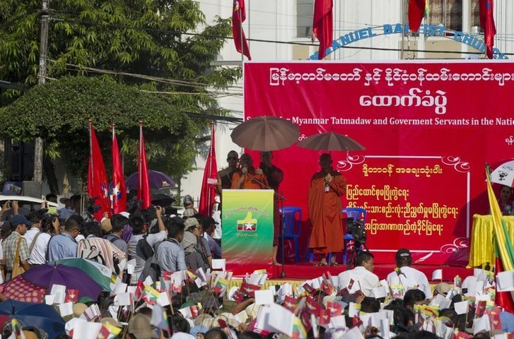 In this Oct 29, 2017 photo, participants with national and military flags listen to speech by a Buddhist monk on the stage during a ceremony supporting the country's military and government servants in Yangon, Myanmar.—AP