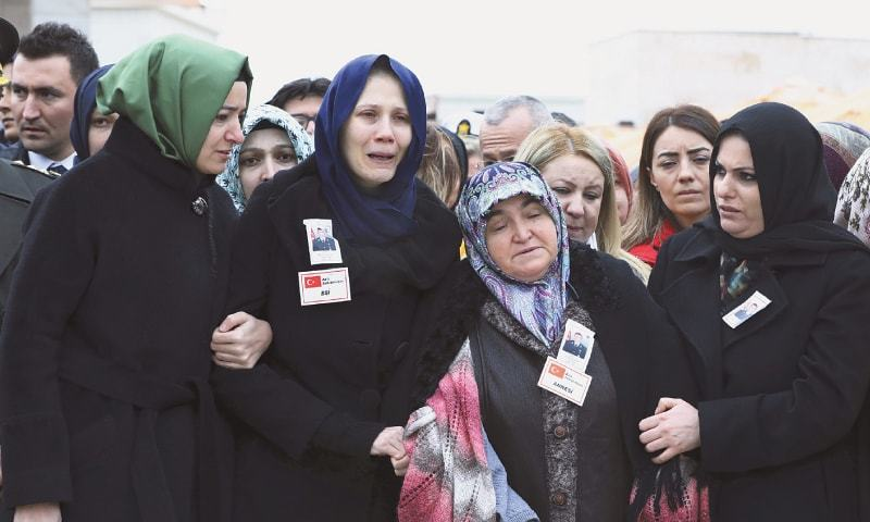 ANKARA: Relatives mourn during the funeral prayers for Musa Ozalkan, the first Turkish soldier to lose his life in the cross-border operation in northern Syria.—AP