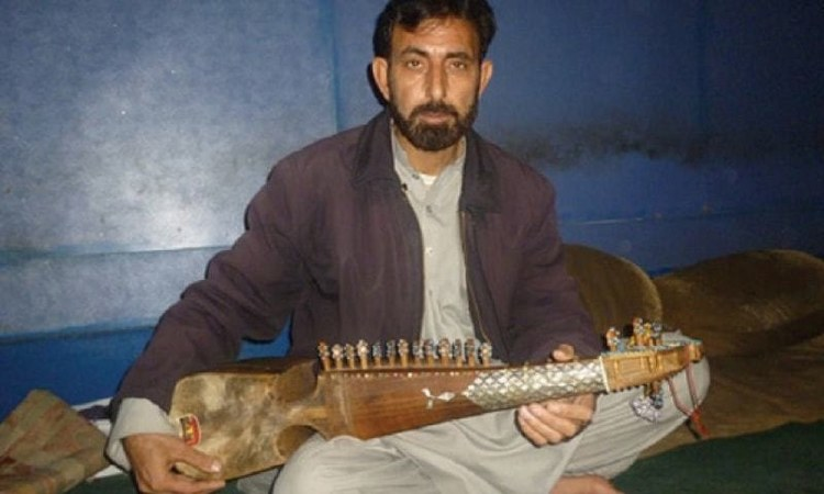 A Pashto artist plays the rabab on Peshawar's Kabari Bazaar music street - Dawn