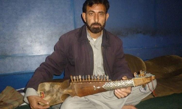 A Pashto artist plays the rabab on Peshawar's Kabari Bazaar music street - Dawn