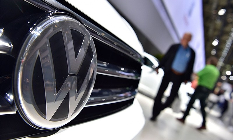 In this file photo taken on June 22, 2016 a Volkswagen logo is seen on a VW Tiguan on display during German carmaker Volkswagen shareholders' annual general meeting.─AFP