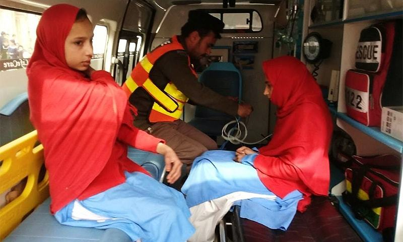 Schoolgirls in Landi Arbab receive medical attention following the earthquake. ─ DawnNews