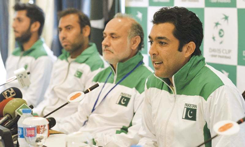 PAKISTAN'S ace tennis player Aisam-ul-Haq speaks at a press conference on Wednesday as Hameed, Aqeel and others look on.