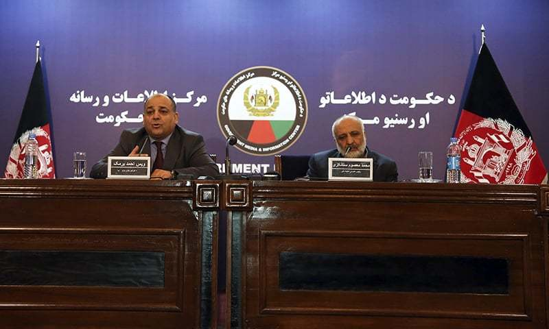 Wais Ahmad Barmak, interior minister, left, and Masoom Stanekzai, Afghanistan's intelligence chief, right, speak during a joint press conference in Kabul, Afghanistan on Thursday.— AP