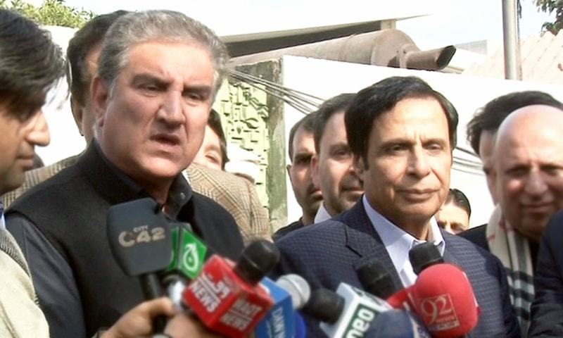 PTI Vice Chairman Shah Mahmood Qureshi and PML-Q leader Pervaiz ELahi speak after a meeting in Lahore. —DawnNews