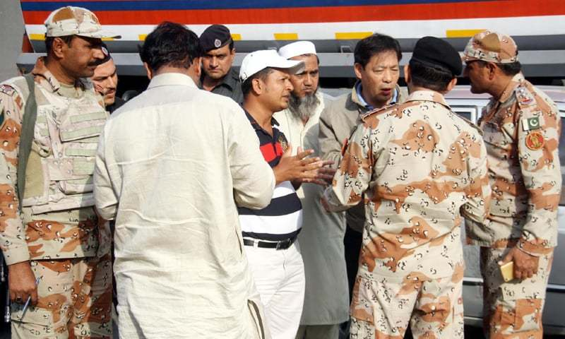 KARACHI: A Chinese national gives Rangers personnel details of the attack on Monday.—Online