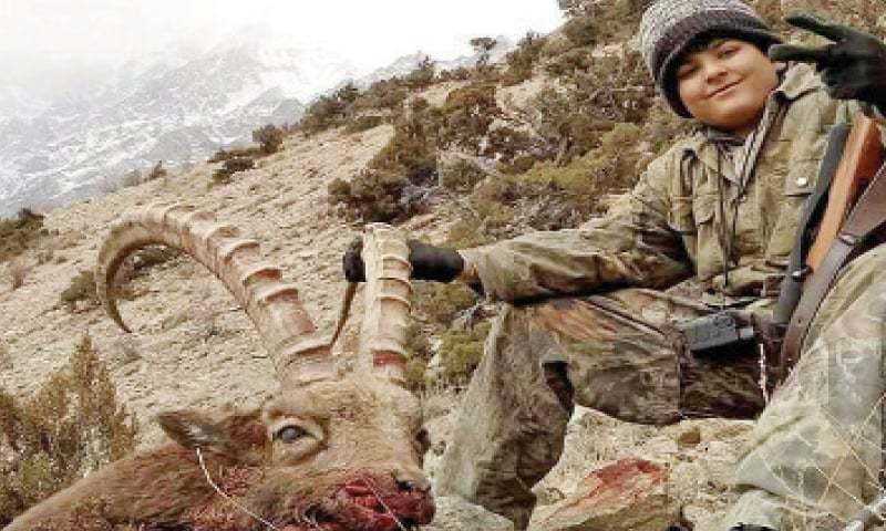 Imam Haroon along with his trophy in Gojal valley, upper Hunza. — Dawn