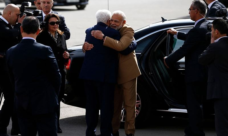 Palestinian president Mahmud Abbas (C-L) embraces Indian Prime Minister Narendra Modi upon his arrival for a meeting in the West Bank city of Ramallah on February 10, 2018. — AFP